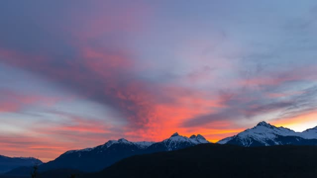 Time lapse of clouds over Tantalus Range in BC Canada at colorful sunset UHD Ultra high definition time lapse movie of moving clouds and blue sky over snow covered Tantalus Range in British Columbia Canada during winter season at colorful sunset 3840x2160 UHD vancouver canada stock videos & royalty-free footage