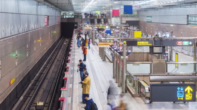 Time lapse of commuters walking and taking MRT during rush hour in Taipei Taiwan video