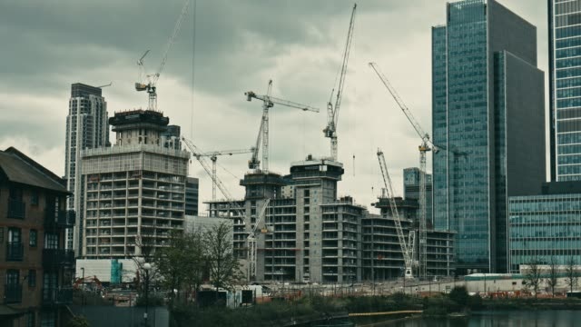 Time Lapse of construction site of a new development in Canary Wharf, London Time Lapse of construction site of a new development in Canary Wharf, London. uk border stock videos & royalty-free footage