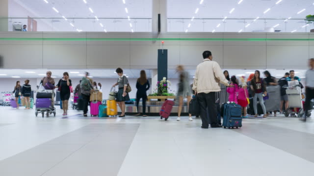 Time Lapse of Crowd collecting baggage from airport conveyer belt video