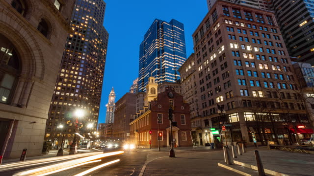 4K Time lapse of crowd people and traffic in front area of Boston old state house at the twilight time, Massachusetts, USA downtown skyline, Architecture and building with tourist concept.