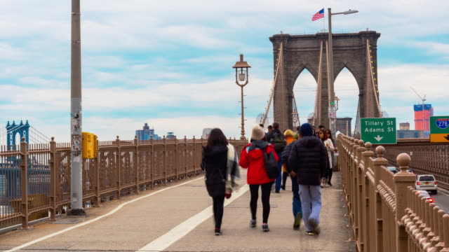 4K Time lapse of crowd  tourist walking at Brooklyn Bridge, Manhattan, New York City, United States