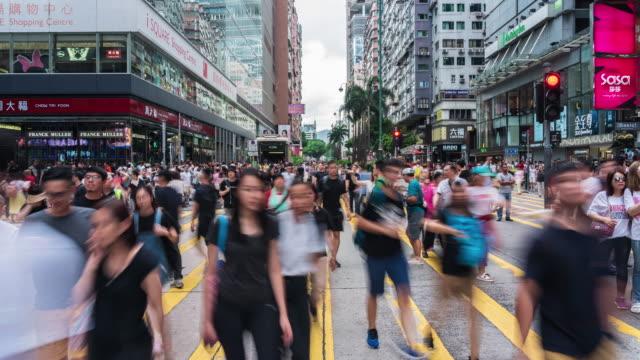 4k time lapse of crowd unrecognizable protester walking around tsim sha tsui street area, hong kong - hong kong video stock e b–roll