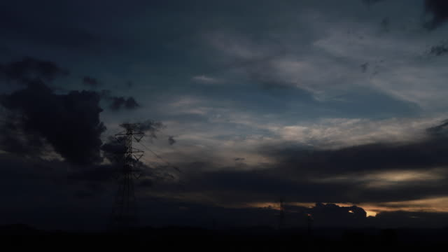 Time Lapse of Electric High Voltage Pylon.Silhouette of Electricity Power Lines.Tower and High Voltage Power Line at sunset. video