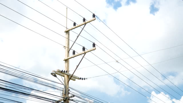 time lapse of electricity post with blue sky video