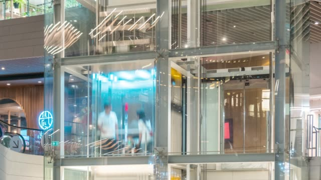 time lapse of elevators in the shopping mall,tilt down - tilt down stock videos & royalty-free footage