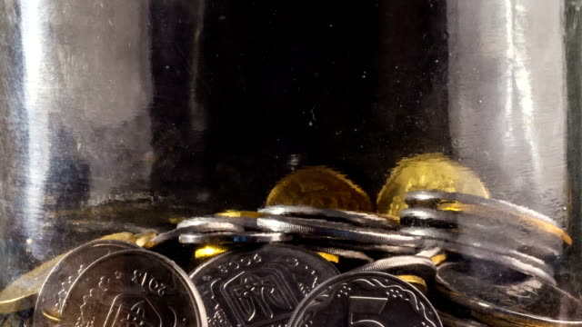Time Lapse of Falling Coins in the Jar Time Lapse of Falling Coins in the Jar. jar stock videos & royalty-free footage
