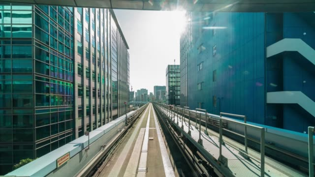 4k time lapse of futuristic scene motion blur movement from tokyo japan train of yurikamome line moving between tunnel in tokyo, japan - tor kolejowy filmów i materiałów b-roll