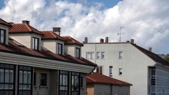 Time lapse of generic Apartment Building With Dormer Windows Time lapse of generic Apartment Building With Dormer Windows and clay roof tiles, Galicia, Spain dormir stock videos & royalty-free footage