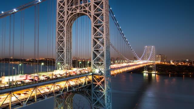 time lapse of geo bridge in nyc at dusk - bridges stock videos & royalty-free footage