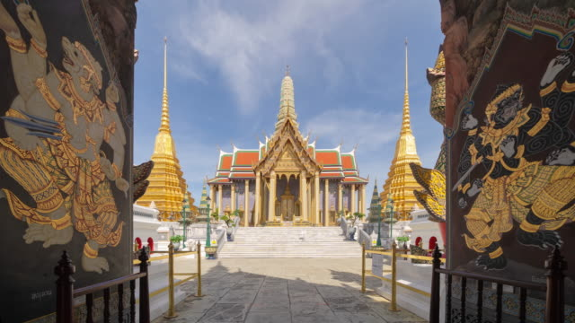 Time lapse of Golden pagoda at Temple of the Emerald Buddha or Wat Phra Kaew and Grand palace in old town, urban city. Bangkok, Thailand. Buddhist temple, Thai architecture. A tourist attraction