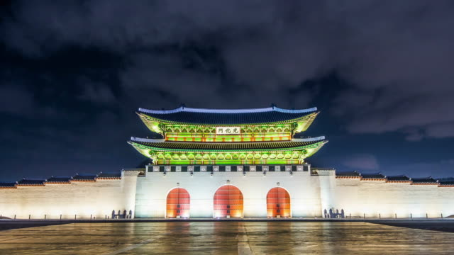 Time lapse of Gyeongbokgung palace and traffic at night in Seoul,South korea. Time lapse of Gyeongbokgung palace and traffic at night in Seoul,South korea. gwanghwamun gate stock videos & royalty-free footage