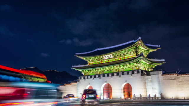 Time lapse of Gyeongbokgung palace and traffic at night in Seoul,South korea. Time lapse of Gyeongbokgung palace and traffic at night in Seoul,South korea.4K. gwanghwamun gate stock videos & royalty-free footage