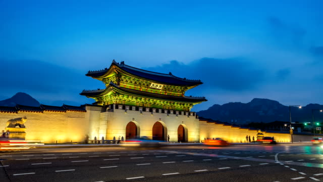 Time lapse of Gyeongbokgung palace and traffic at night in Seoul,South korea.(Zoom out) Time lapse of Gyeongbokgung palace and traffic at night in Seoul,South korea.(Zoom out) gwanghwamun gate stock videos & royalty-free footage