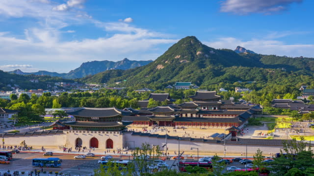 Time lapse of Gyeongbokgung palace and traffic speeds of car light in Seoul,South Korea.Zoom in Time lapse of Gyeongbokgung palace and traffic speeds of car light in Seoul,South Korea.Zoom in gwanghwamun gate stock videos & royalty-free footage