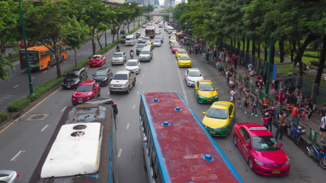 Time lapse of heavy traffic with people on the street video