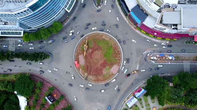 Time lapse of hectic traffic at Kelapa Gading Roundabout Time lapse of crazy traffic at Kelapa Gading roundabout in Jakarta jakarta stock videos & royalty-free footage