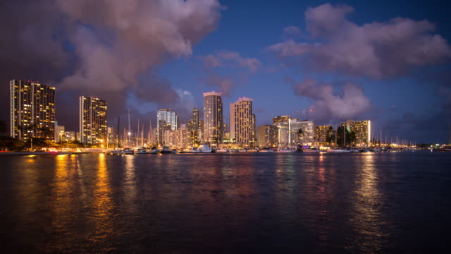 Time lapse of Honolulu downtown at night Time lapse of Honolulu downtown at night waikiki stock videos & royalty-free footage