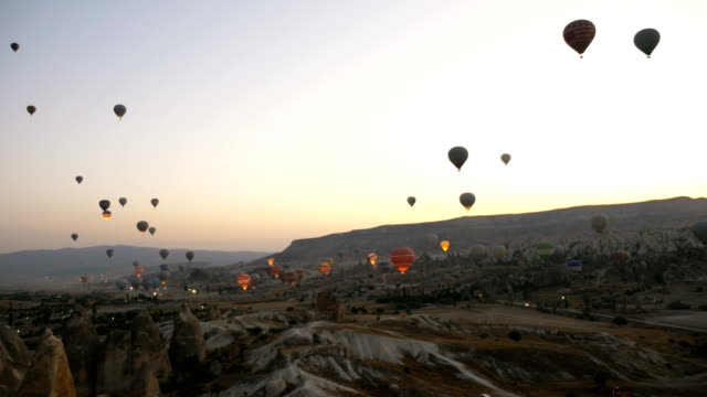 Time lapse of hot air balloons flying over the Goreme  at Cappadocia video