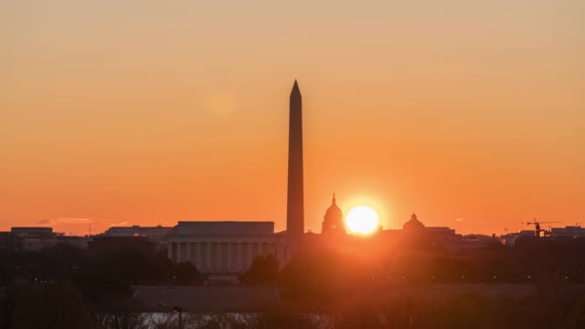 4K Time lapse of Lincoln Memorial, Washington Monument and United States Capitol Building at sunrise time from Netherlands Carillon, Washington, D.C., USA
