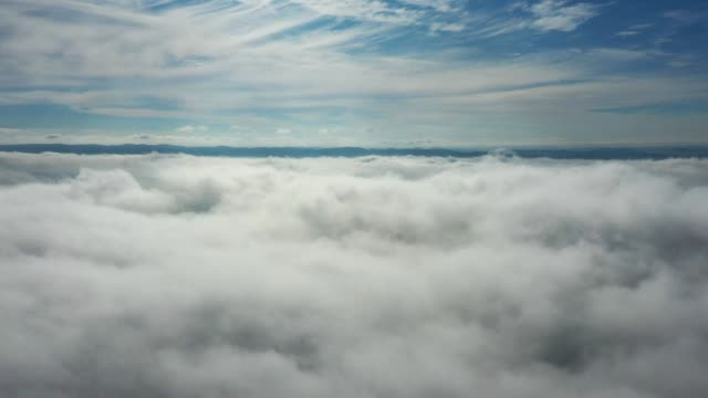 Time lapse of lying above clouds with great landscape.