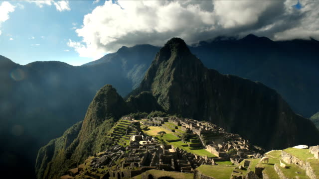 time lapse of machu picchu on a sunny afternoon - antica civiltà video stock e b–roll
