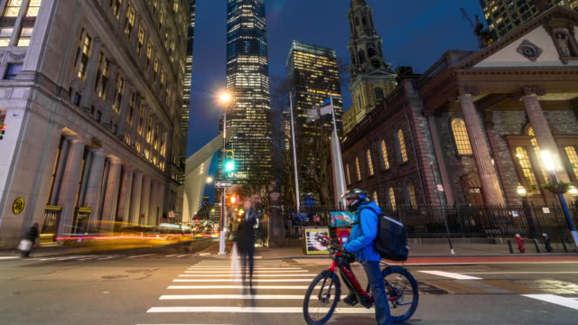 4K Time lapse of manhattan New York Cityscape with St. Paul's Chapel of Trinity Church at the twilight time, Manhattan, New York City, USA, Architecture and landmark with transportation concept