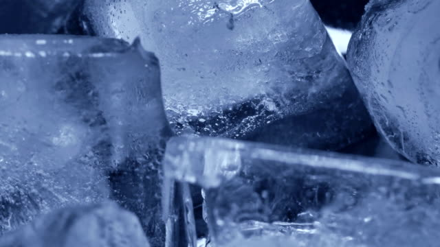 Time lapse of melting group of ice cubes. Close up shot camera Time lapse of melting group of ice cubes. Close up shot camera ice stock videos & royalty-free footage