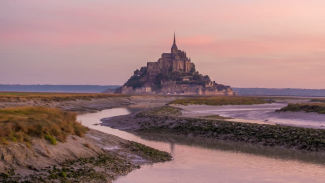 Time lapse of Mont Saint-Michel view with sunset light in Normandy Time lapse of Mont Saint-Michel view with sunset light in Normandy, northern France fort stock videos & royalty-free footage