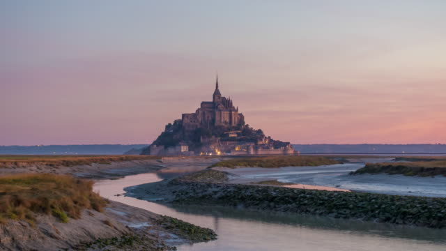 Time lapse of Mont Saint-Michel view with sunset light in Normandy Time lapse of Mont Saint-Michel view with sunset light in Normandy, northern France normandy stock videos & royalty-free footage