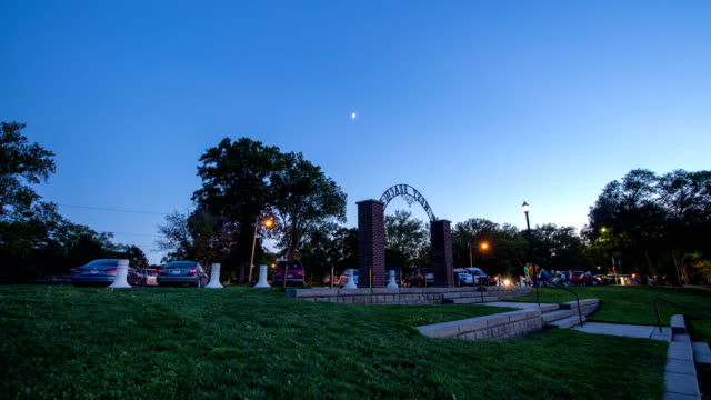Time Lapse of Moon During Dusk Over Park video