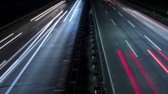 Time lapse of motion blurred headlights - highway high-angle view Time lapse of motion blurred headlights - highway high-angle view autobahn stock videos & royalty-free footage