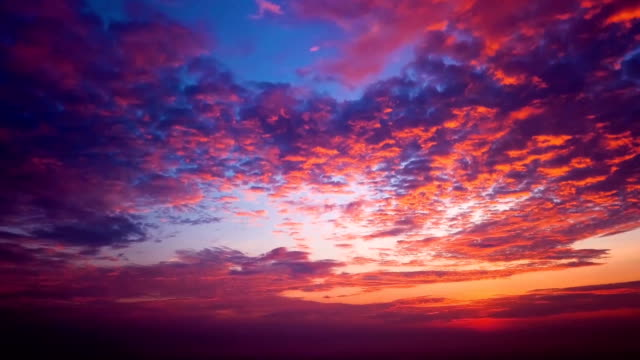 Time lapse of Moving Cloud in sunset sky with aerial view