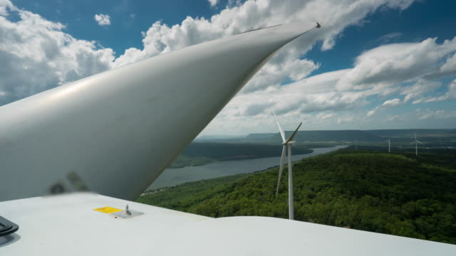 Time Lapse of moving cloud over Wind Turbine Electric Generator