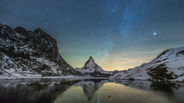 Time Lapse of moving Star night over Matterhorn mountain video