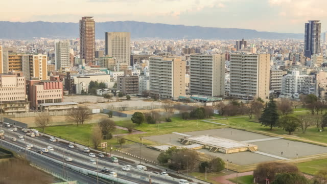 time lapse of osaka skyline - tilt down stock videos & royalty-free footage