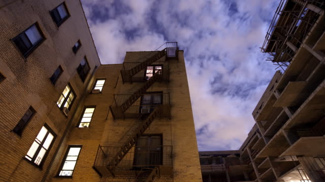 Time lapse of partments at night with clouds video