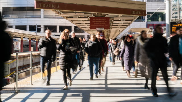 4K Time lapse of passenger and tourist walking via walk way of train railroad station transportation hub in rush hour in Boston, Massachusetts, USA. Transportation and Traveler concept