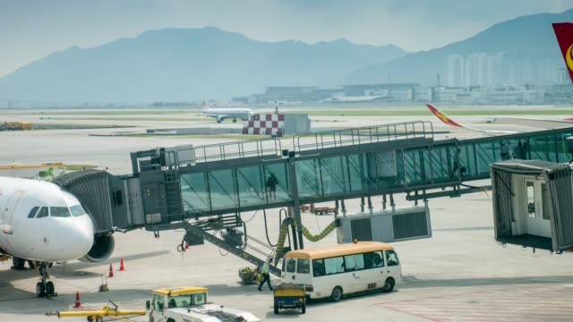 Time Lapse of Passenger boarding from airport terminal to aircraft Time Lapse of Passenger boarding from airport terminal to aircraft 4K(UHD) airfield stock videos & royalty-free footage