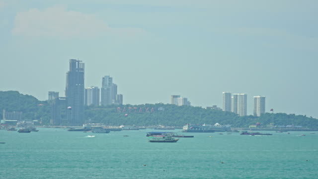 Time lapse of Pattaya city with architecture building nearly sea ocean beach in Thailand