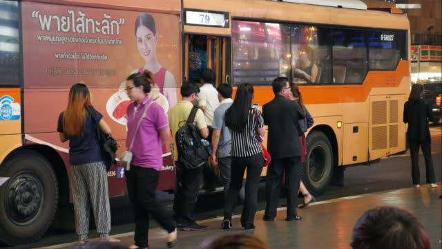 Time lapse of people at bus stop Time lapse of People at the bus stop near a shopping mall in Bangkok. Using public buses is a common way for commuting in Bangkok for many people. Cars and a bus are on the road. bus stop stock videos & royalty-free footage