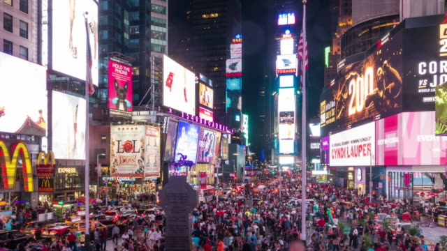 Time lapse of people in Times Square at night in Midtown Manhattan video