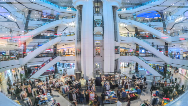 4k time lapse of people using the escalators and lift and shop in shopping mall - escalator video stock e b–roll