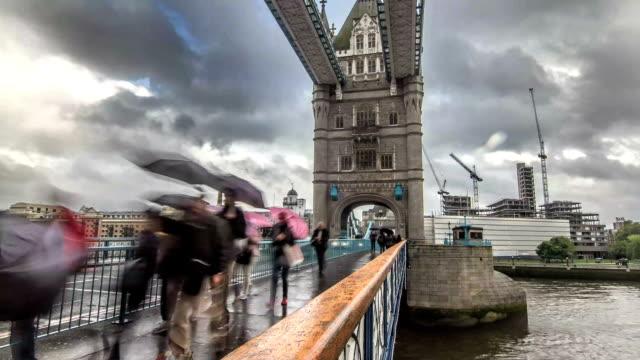Time lapse of people walking along Tower Bridge Road walkway, London video