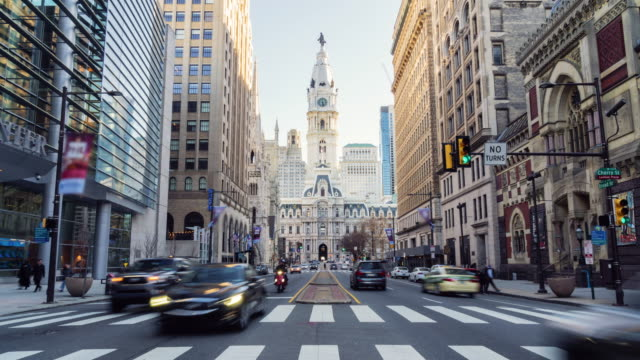 Time lapse of Philadelphia's landmark historic City Hall and car traffic in Pennsylvania, United States