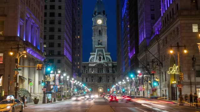 4K Time lapse of Philadelphia's landmark historic City Hall building at twilight time with car traffic light, United States of America or USA, history and culture for travel concept