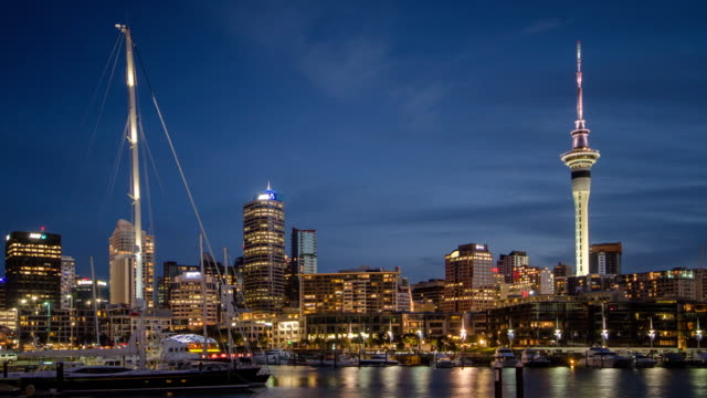 Time Lapse of port of auckland city day to dusk time twilight shot after sunset , new zealand , dolly shot left to right video