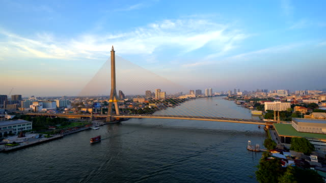 time lapse of rama 8 bridge and chao phraya river in structure of suspension architecture concept, urban city, bangkok. downtown area at sunset, thailand. - fiume chao phraya video stock e b–roll