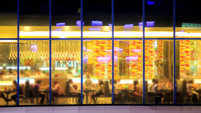 Time lapse of Restaurant cafe from outside at night