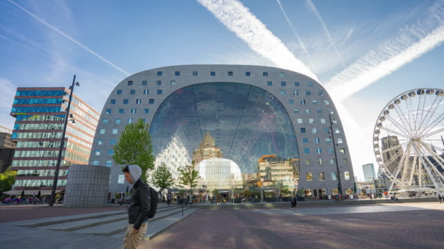 time lapse of rotterdam city with markthal market in rotterdam, netherlands. - rotterdam video stock e b–roll